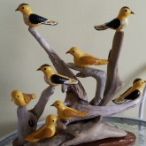 A cluster of yellow birds wood carving by Charlie Poirier, Cheticamp, Nova Scotia