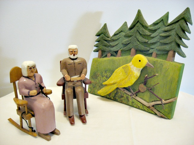Charlie Poirier. The carver, his lady and a yellow bird.