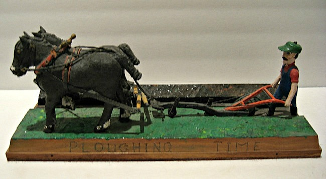 Fred Bailey. Shawville, Que. Carving of a Farmer Plowing with a team. Signed and dated. 1977.