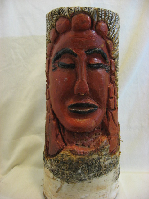 Carving of a Montaignais Indian. In a single block of White Birch wood.