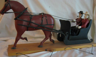 Ernest Belaire Carving of a sleigh and couple. 1960's