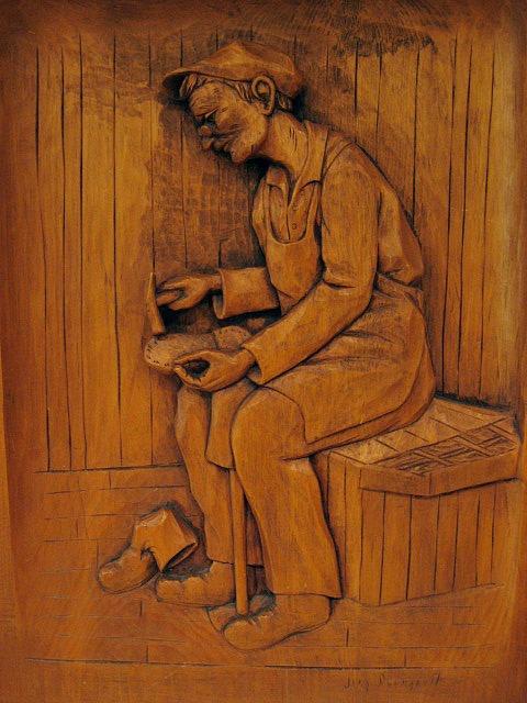 J. P. Bourgault. Saint-Jean-Port-Joli, Quebec. Relief carving of a shoe maker. 1950's.