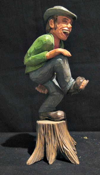 Phillip Renaud. Wood carver. Oshawa, Ontario. A tramp on the stump.