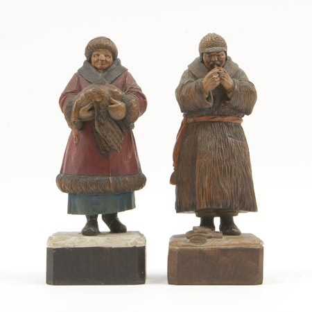 A Quebec couple. A pair of woodcarvings by Paul Archibald Caron. Early 20th Century.