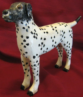Carving of a Spotted Dog by Wilfrid Richard