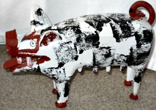 Felicien Levesque. A carving of a Pig.