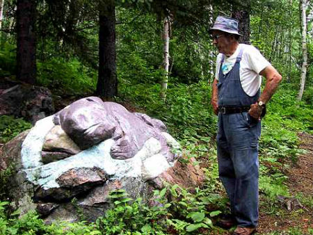 Leon Bouchard with a stone carving.