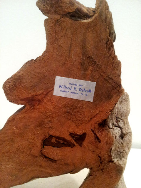 Wilfred R. Dalzell. Woodcarver. Saint John New Brunswick. His mark.