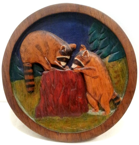 Joyce McComisky. Charlesville, Nova Scotia. Relief carving of young Raccoons.