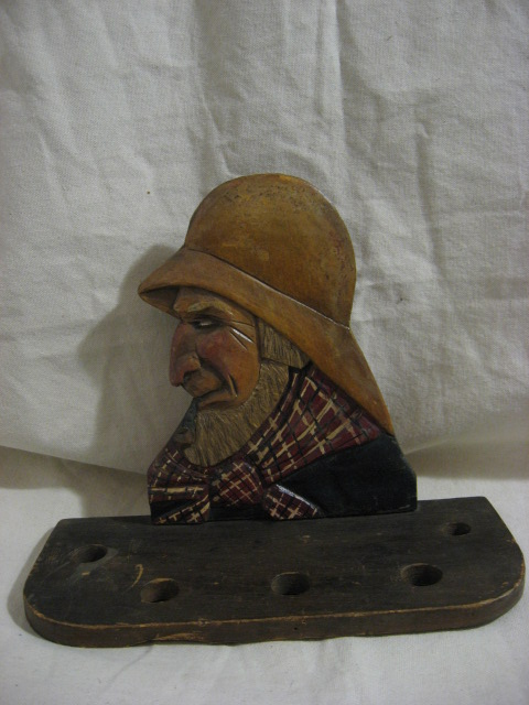 Carl Johan Trygg. Quebec. Carving of a Pipe Rack with Fisherman.