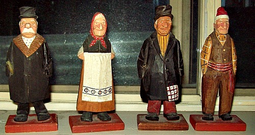 Wood carvings signed Rand. Verdun. Four Carved Figures.