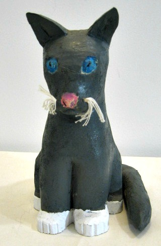 Herve Lessard. Carving of a Grey Cat