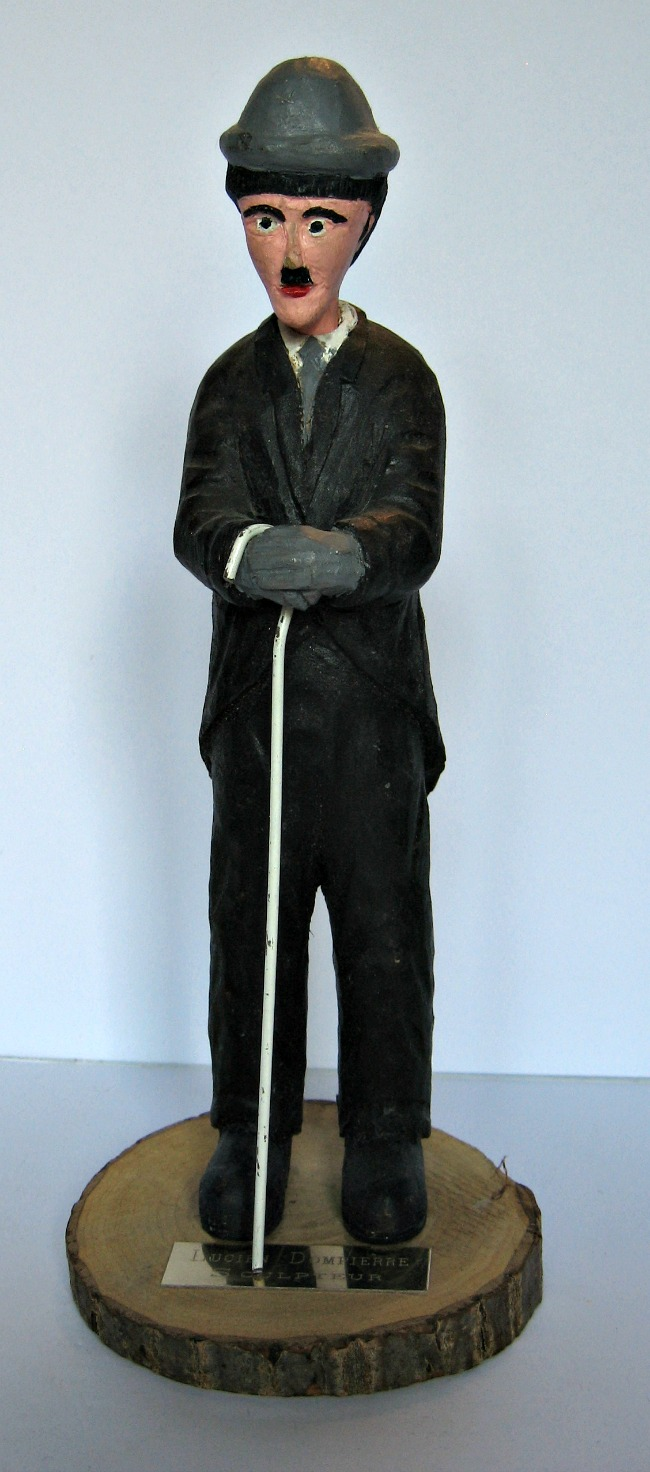 Lucien Dompierre. Laval, Quebec. 1931-2013. Signed painted carving of Charlie Chaplin.