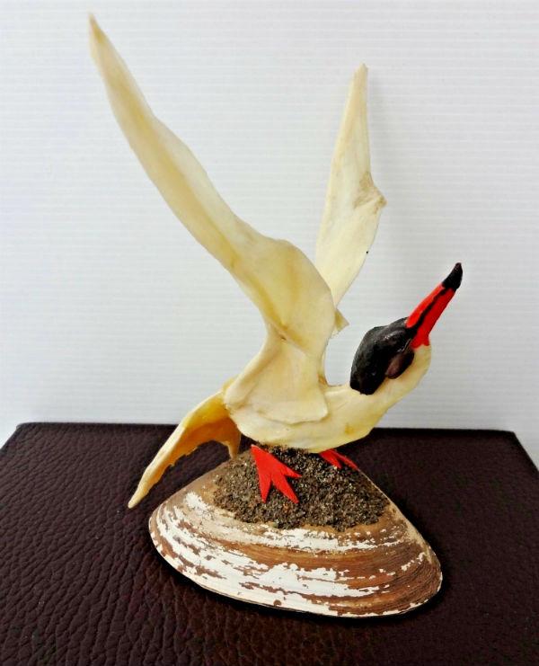 Reynald Cullen. Gaspe, Que. Sculpture of a Gull. Shell and Moss.