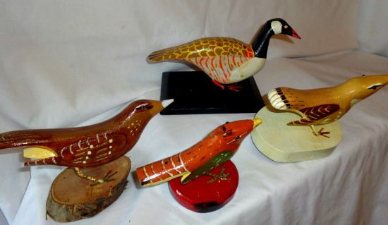 H. Hobbs. A group of carved birds.