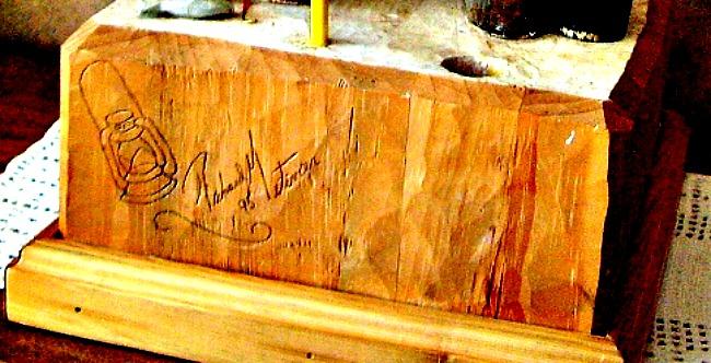 Richard Metivier. Quebec. Sculptor. Wood carver. Active 1995. His mark.