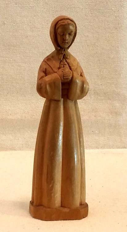 Signed Carving of a Nun Jeanette Bourgault.