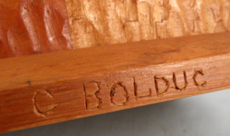 C Bolduc. Quebec.Naive Carving of a Lumber Jack .The mark.